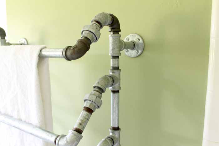 This rustic towel rack is make with galvanized pipes