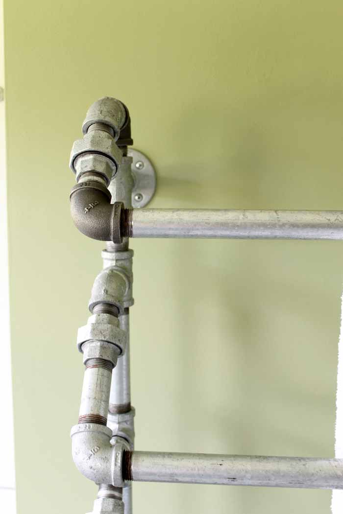 We used standard galvanized pipe connections to make a rustic pipe towel rack