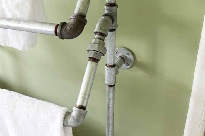 This rustic towel rack is made with galvanized pipe pieces!