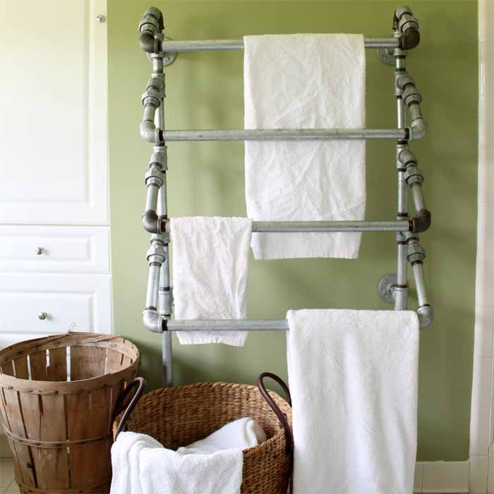 This functional rustic towel rack is made with pieces of galvanized pipe, and is a great addition to your bathroom!