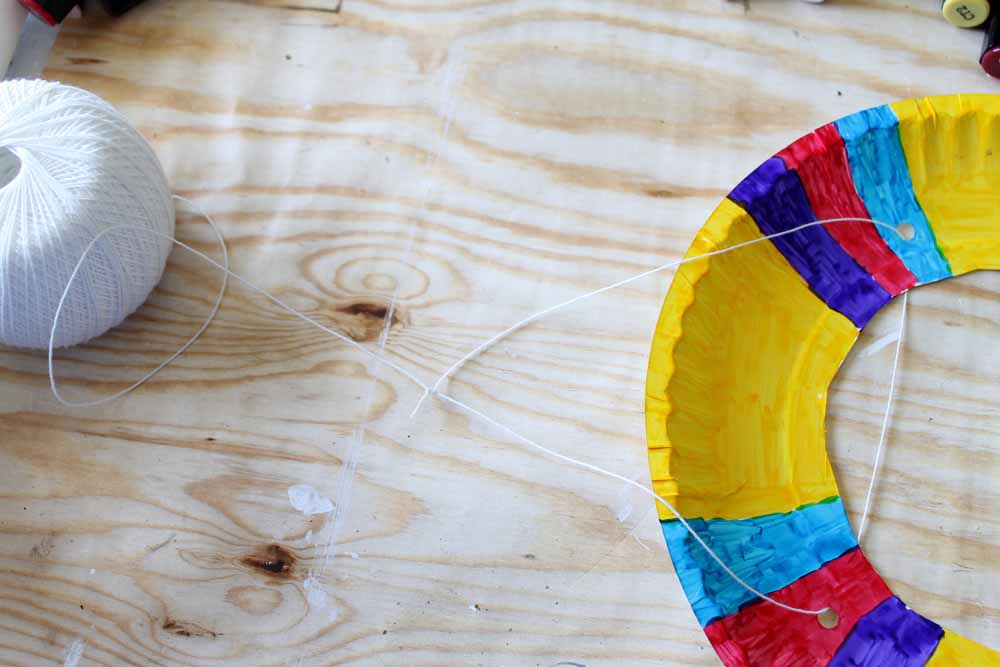 Add kite string to your paper plate kite body