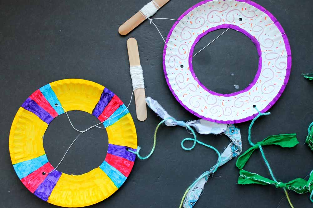 This paper plate kite craft is the perfect summer craft for kids