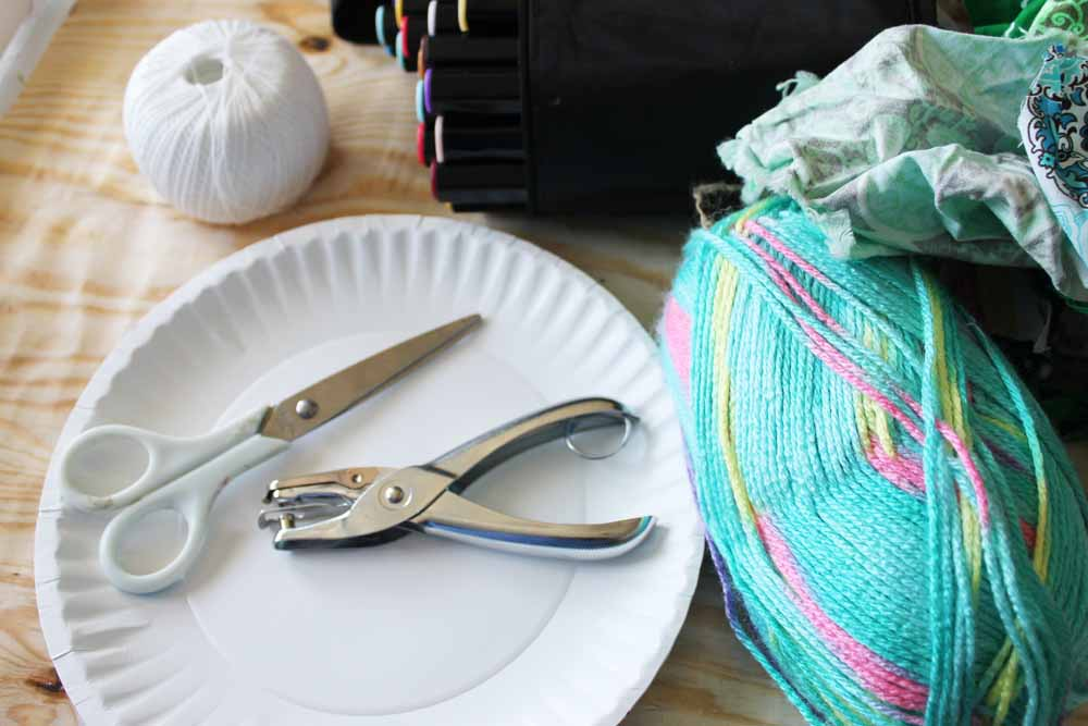 Here are the supplies you need to make a paper plate kite