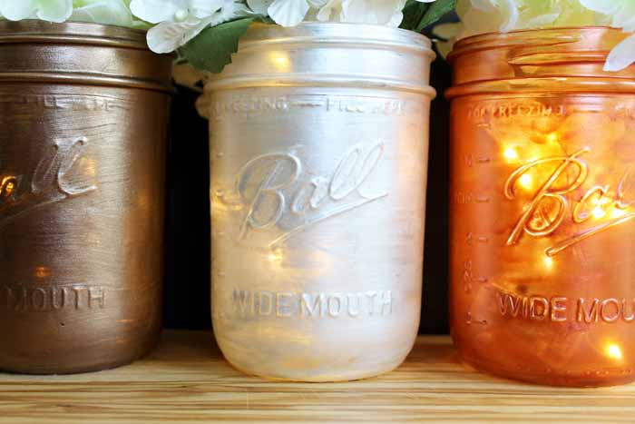 These mason jar wedding centerpieces are easy to make for your reception!