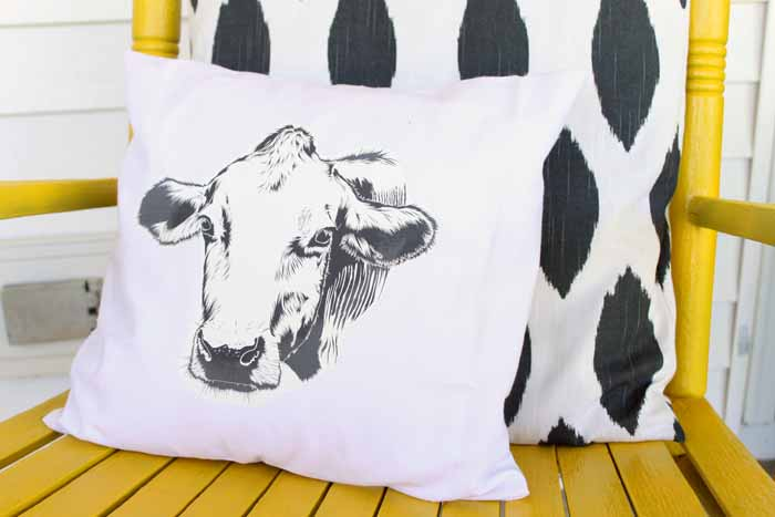 Make this farmhouse pillow for your home in a few simple steps! You will love the cow silhouette!