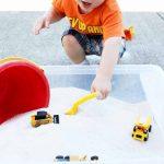Kid scooping sand