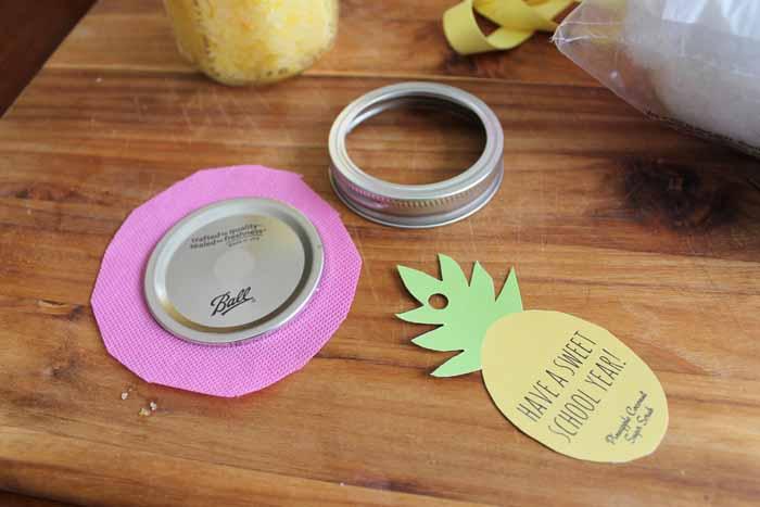 pink fabric under mason jar lid. Pineapple gift tags.