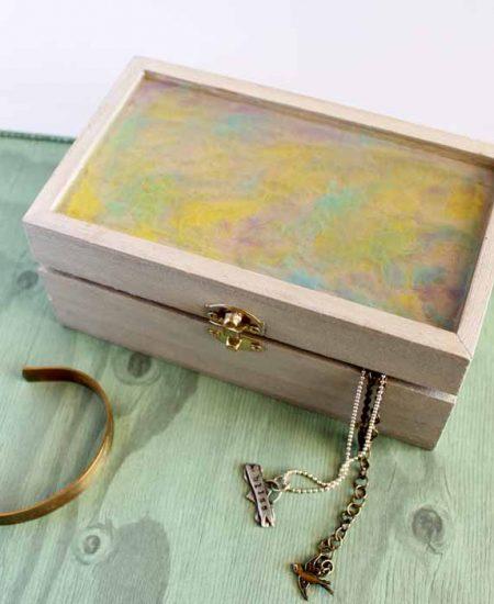 diy jewelry box on green wood