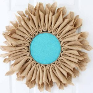 Learn how to make burlap flowers! A simple project that will look great as a wreath or in your home decor!