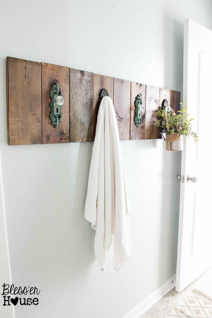I love this rustic bathroom towel holder made from vintage door handles.