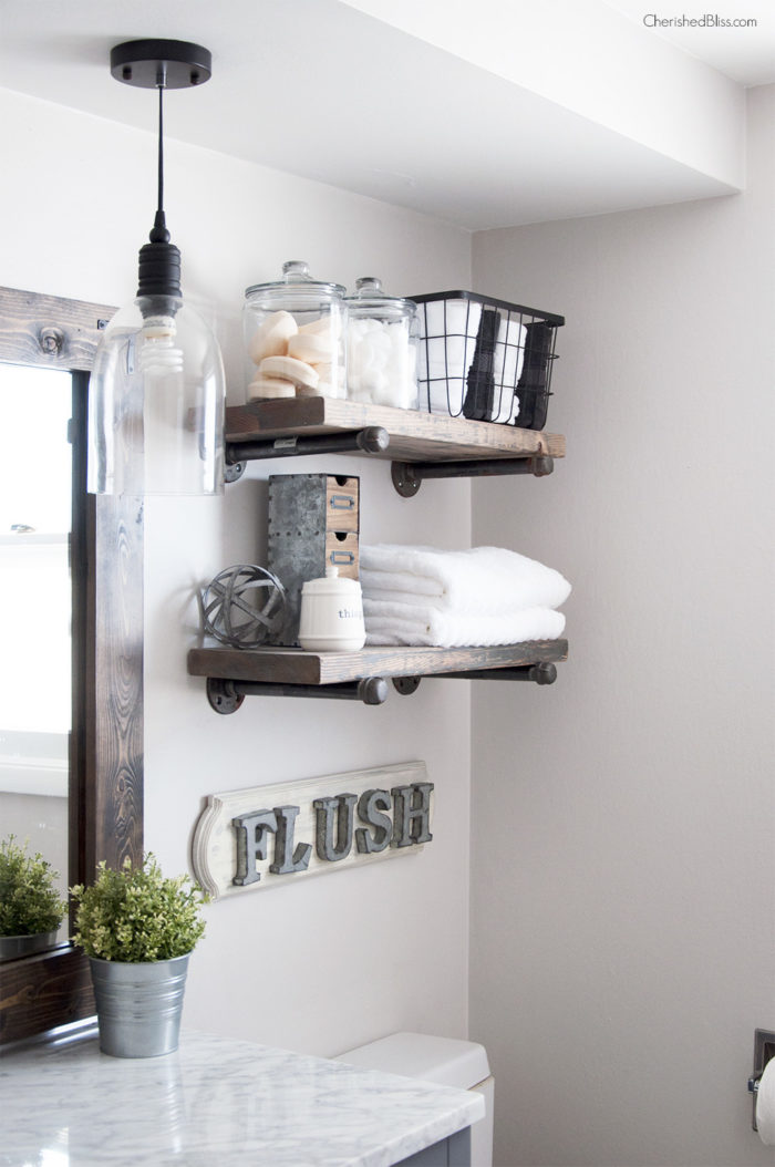 A rustic wood and pipe shelf is an easy way to add storage and rustic style to your bathroom