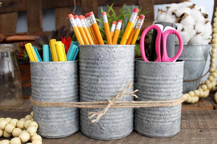 Make this school organizer for your home! Perfect farmhouse style for an office or any room! Use tin cans and a faux concrete finish for a quick and easy craft project!