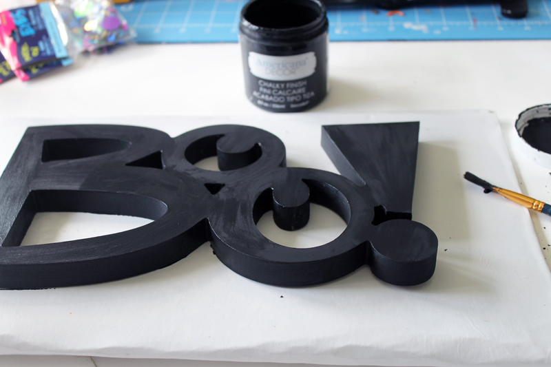 Make this boo sign for Halloween! You will love this sign made from google eyes!