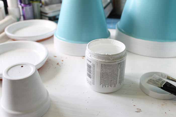 Flower pots painted white and blue