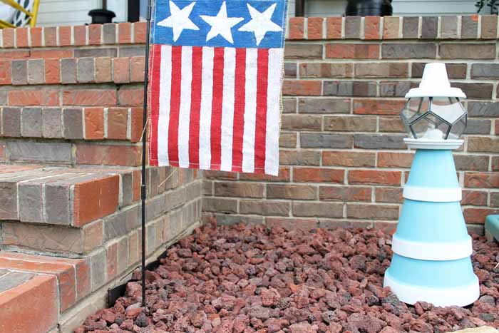 Flower pot lighthouse with American flag