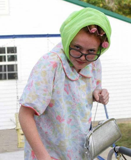 A person wearing and old lady halloween costume