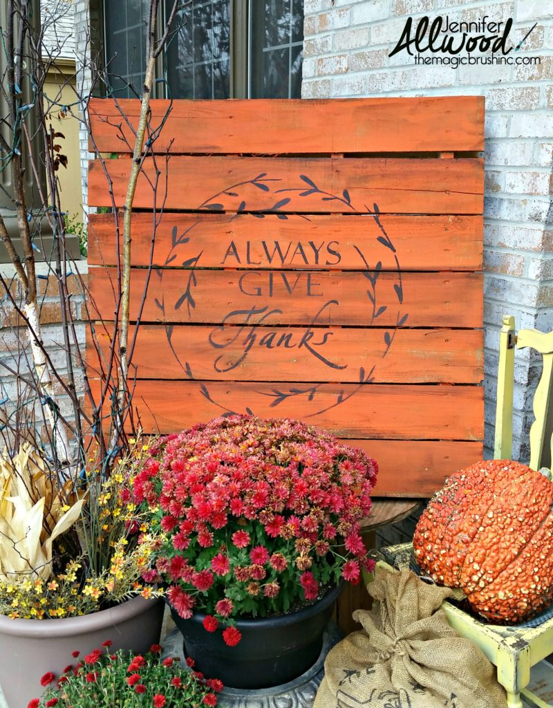 Give Thanks pallet sign with mums and a pumpkin