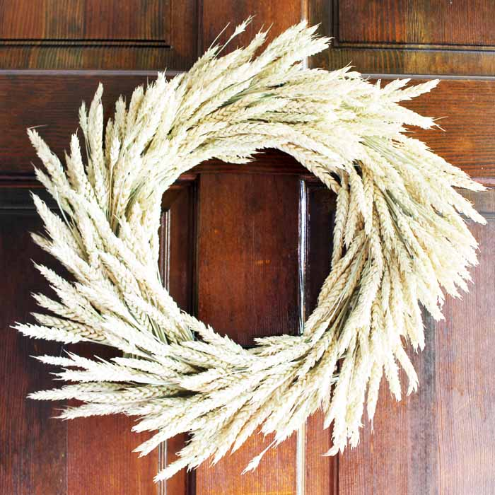 This DIY wheat wreath is perfect fall decor.