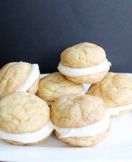 Snickerdoodle whoopie pies on a white plate