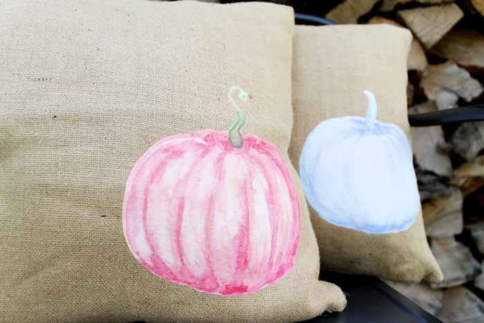 Make a pumpkin pillow with these easy to follow instructions! Includes download of watercolor pumpkin images!