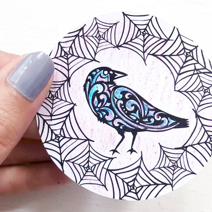 Make this raven sun catcher for Halloween! A quick and easy project with your Cricut!