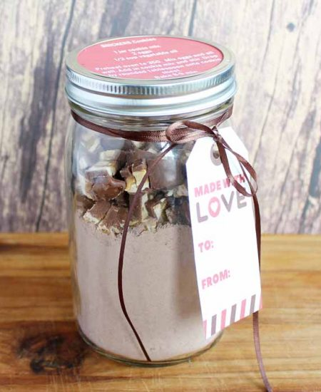 Mason Jar Cookie Mix gift on a wooden backdrop