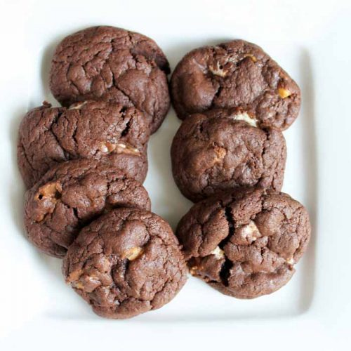 hot snickers cookies on a white plate