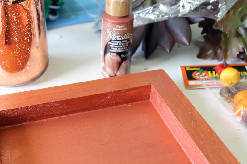 orange painted frame on wooden backdrop