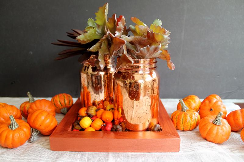 mason jars in orange tray with pumpkins