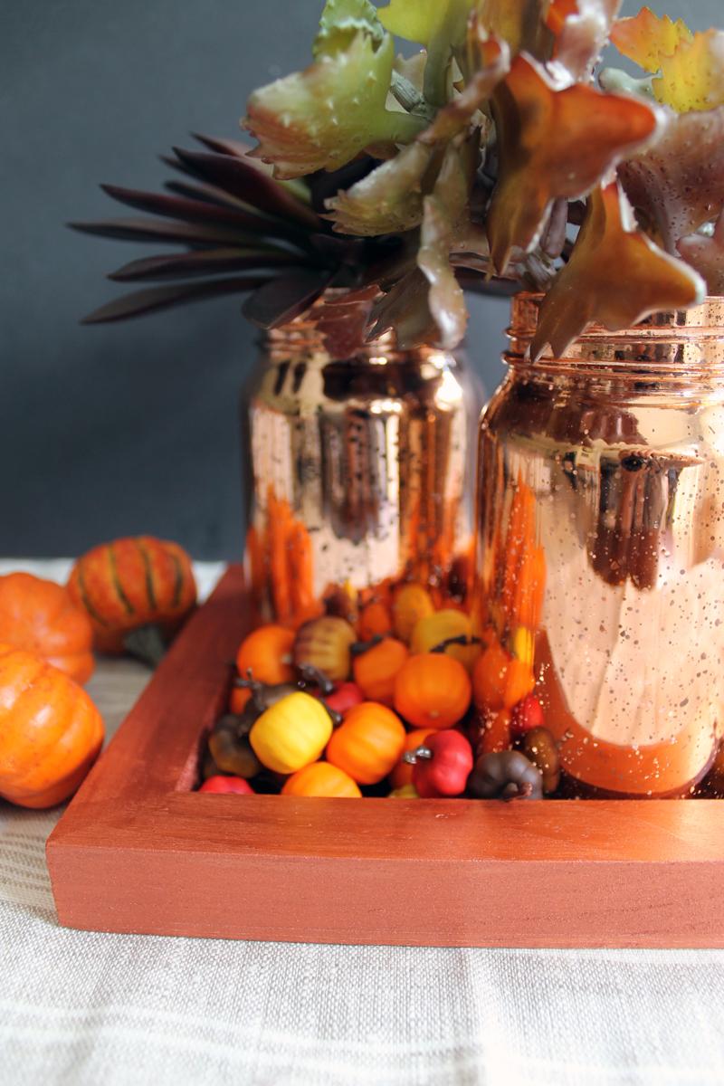 orange tray with metallic orange mason jars