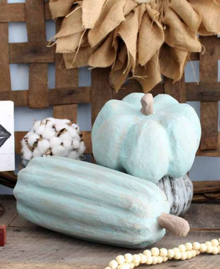 close up of diy painted pumpkins in a fall display