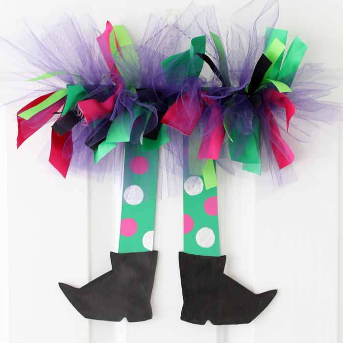 These colorful witch legs are fun and easy Halloween decor you can make in minutes