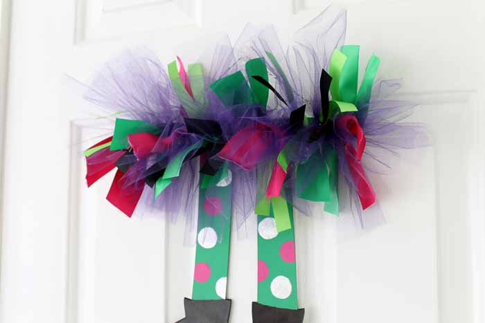 You can hang these colorful halloween witch legs anywhere in your home