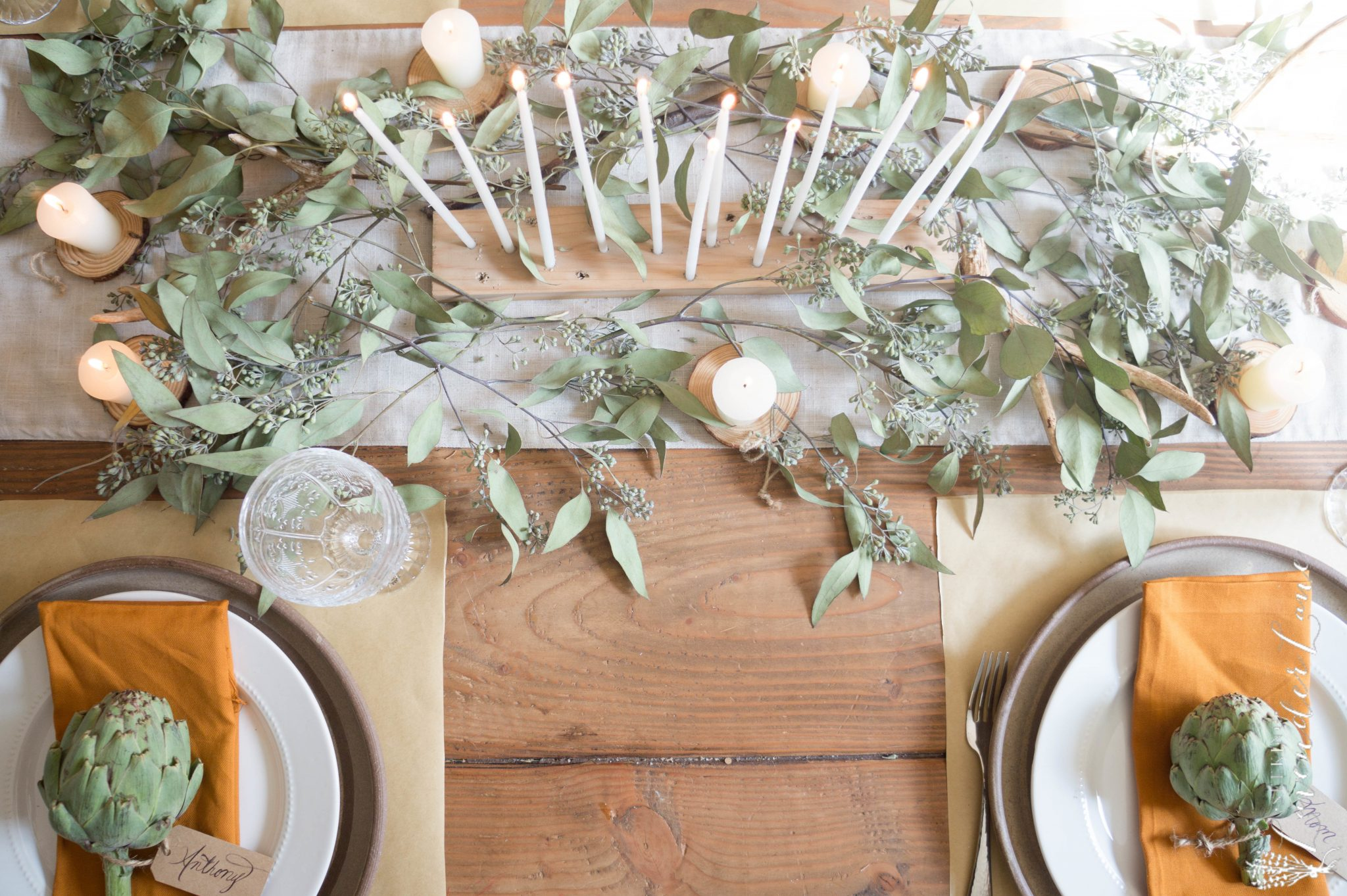 greenery on a table set for thanksgiving