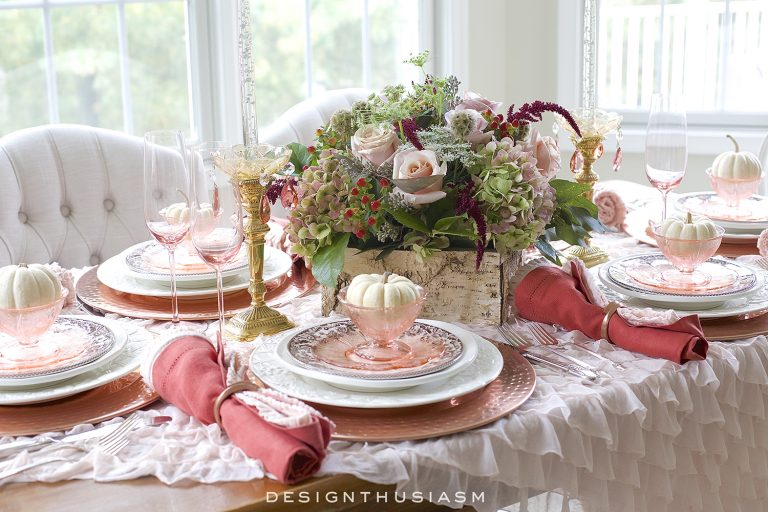thanksgiving table with pink flowers and linens