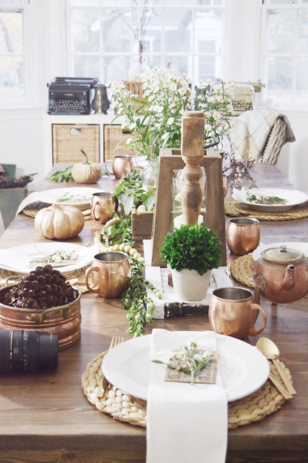 copper and wood accents on a fall table