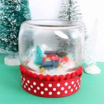 Add a train to a mason jar to make this Christmas snow globe!