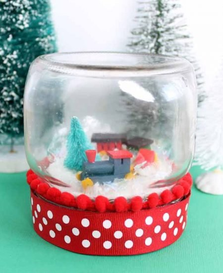 Add a train to a mason jar to make this Christmas snow globe!