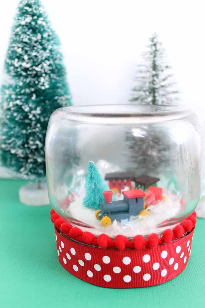 christmas snow globe adding a train to a jar the country chic cottage