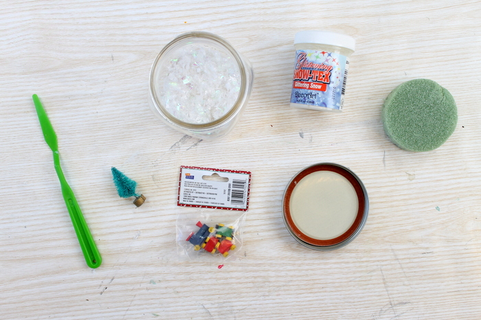Supplies to make your own Christmas snow globe.
