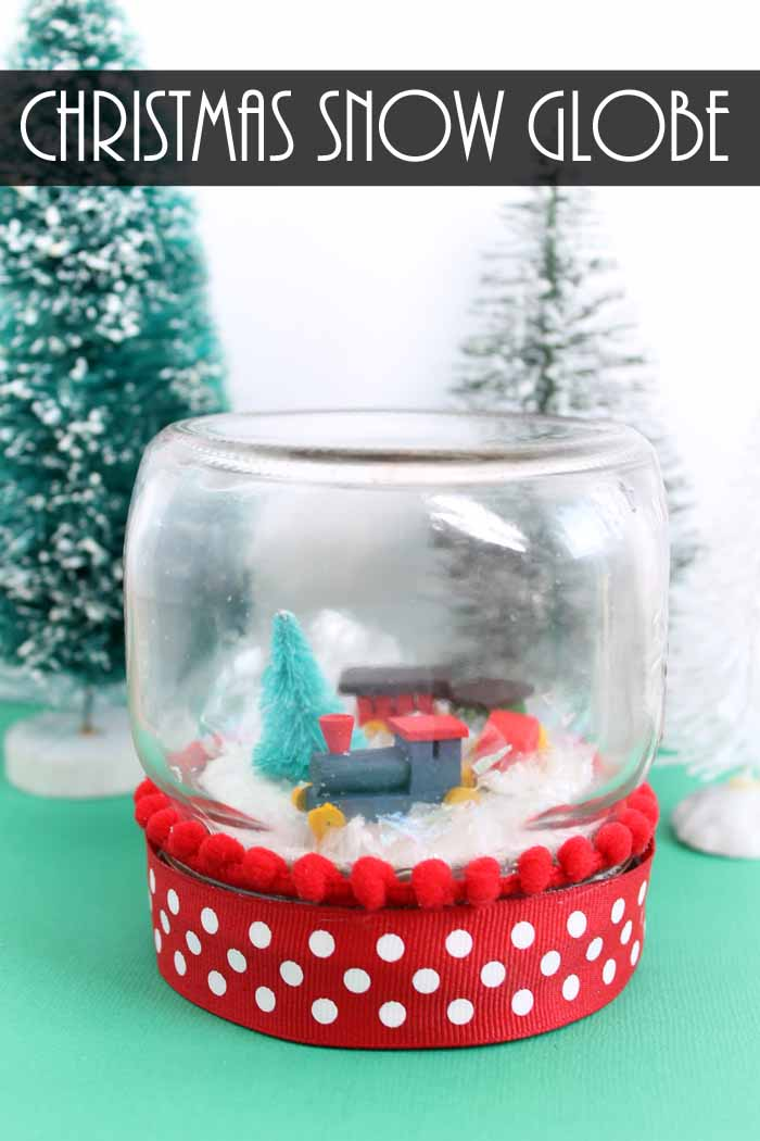 Make a Christmas snow globe in minutes with this super easy technique! Add a miniature train to a mason jar! #christmas #masonjar #snow