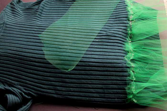 adding green tulle to sweater with hot glue