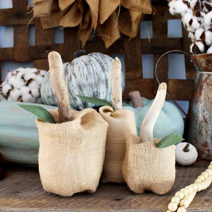 Make these fabric pumpkins for you home! In just 5 minutes, you too can make these no sew burlap pumpkins!