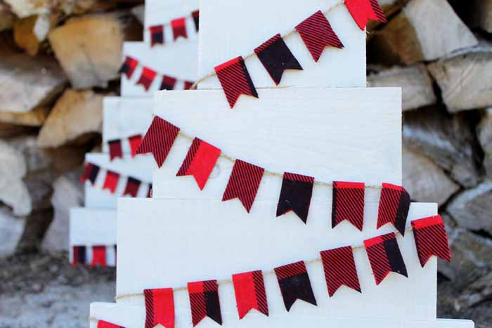 Plaid pennant banner on a pallet Christmas tree.