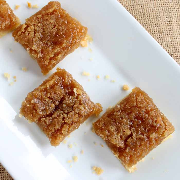 pear crisp recipe cut into squares on a plate
