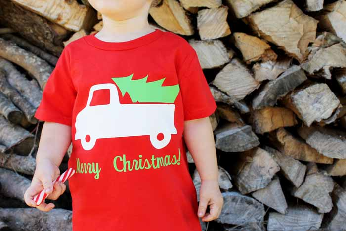 Applying t shirt vinyl with the Cricut Easy Press! Making your own t shirts has never been easier! Design for fall and Christmas with truck included!