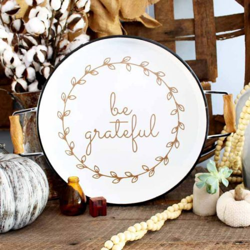 one white plate with be grateful text