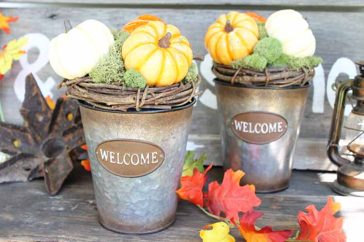 Welcome fall to your home with these simple buckets that are perfect for your porch decor!