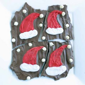 Make this Christmas bark recipe with cute Santa hats! An easy holiday treat that the kids will love!