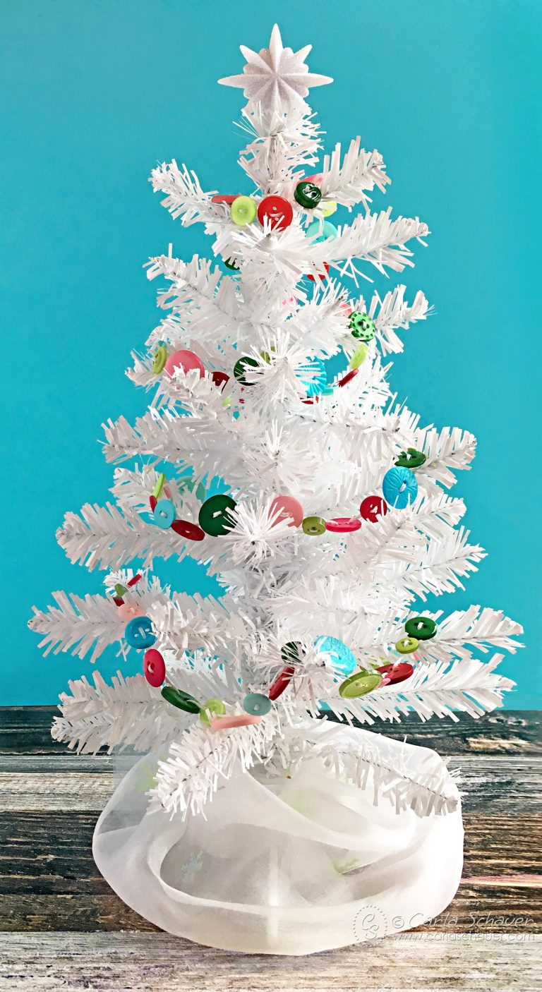 white tree with colorful garland